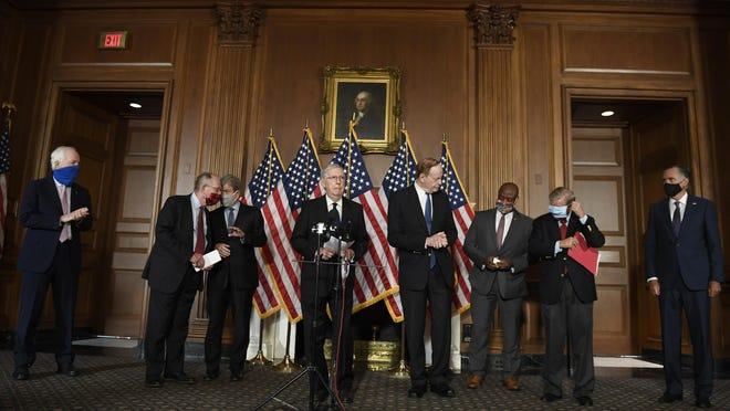 Senate Majority Leader Mitch McConnell of Ky., during a news conference on on Capitol Hill in Washington, Monday, July 27, 2020, to highlight their proposal for the next coronavirus stimulus bill. McConnell is joined by, from left, Sen. John Cornyn, R-Texas, Sen. Lamar Alexander, R-Tenn., Sen. Roy Blunt, R-Mo., Sen. Richard Shelby, R-Ala., Sen. Tim Scott, R-S.C., Sen. Lindsey Graham, R-S.C., and Sen. Mitt Romney, R-Utah.