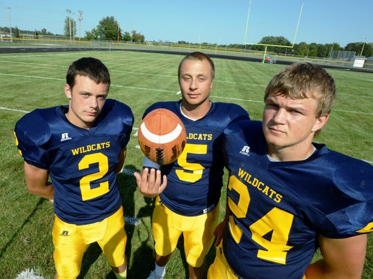 Left to right, Woodmore's DJ Wellons, Connor and Dustin Haar look to lead the Wildcats' offense as a balanced attack in 2015.
