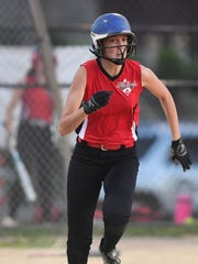 Glen Rock's Ellen Feuss, who suffered a severe concussion in the spring, runs to first during a summer league game.
