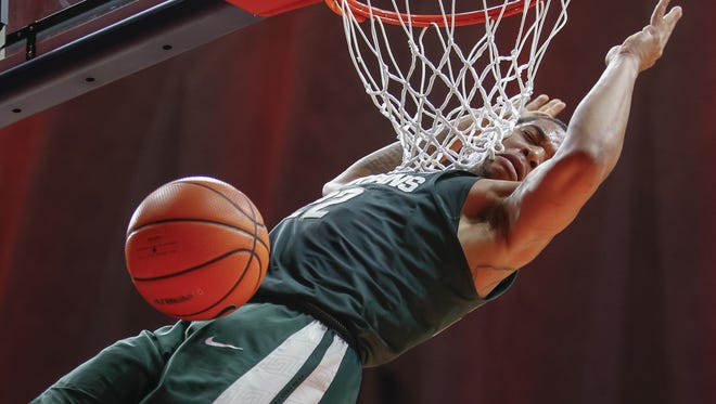 Michigan State's Miles Bridges dunks the ball during MSU's 87-74 win on Monday, Jan. 22, 2018, in  Champaign, Ill.