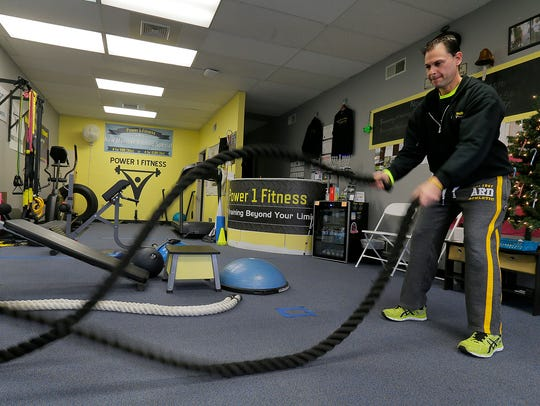Jason Lerman, owner of Power 1 Fitness, works out in
