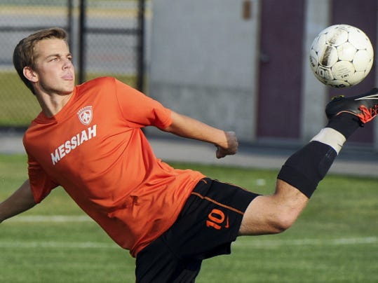 Central York senior Mitchell Crane warms up before the first day of soccer practice Monday at the high school. Athletes across the YAIAA battled high temperatures for the opening of fall sports practice. Most sports open play Sept. 4, although golf and tennis can compete sooner.
