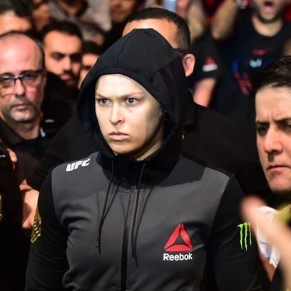 Aug 1, 2015; Rio de Janeiro, RJ, Brazil; Ronda ÒRowdyÓ Rousey (red gloves) looks on prior to her fight against Bethe ÒPitbullÓ Correia (not pictured) during UFC 190 at HSBC Arena. Mandatory Credit: Jason Silva-USA TODAY Sports