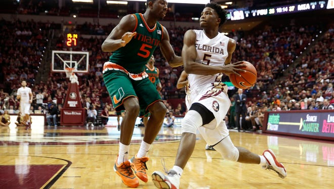 FSU's Malik Beasley drives to the hoop past Miami's Davon Reed during their game earlier this year at the Tucker Civic Center. Beasley has decided to declare for the NBA Draft, becoming FSU's first ever one-and-done player.