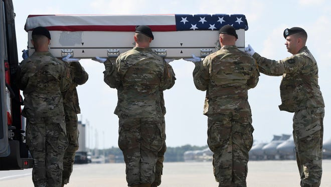 An Army carry team moves a transfer case containing the remains of Sgt. Jonathon Michael Hunter at Dover Air Force Base, Del., Friday, Aug. 4, 2017. According to the Department of Defense, Hunter, 23, of Columbus, Ind., died Aug. 2, 2017, in Kandahar, Afghanistan, of injuries sustained from an improved explosive device.