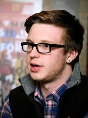 St. John's University student Michael Swearingen talks Tuesday about #OccupyYikYak at St. John's University.