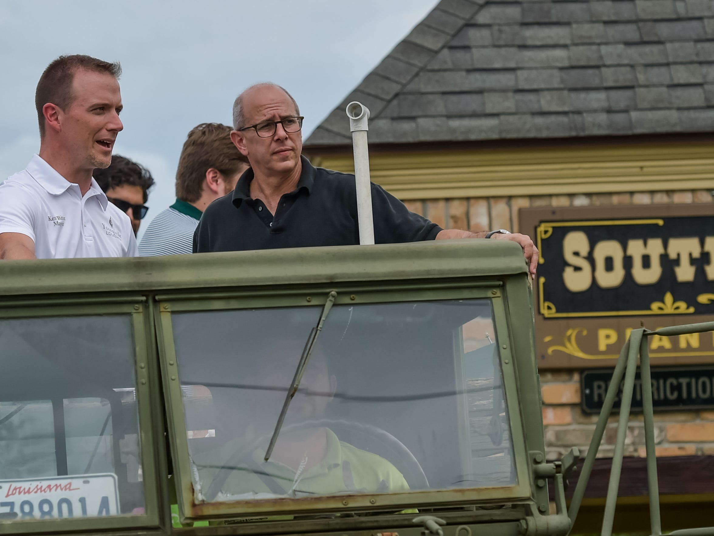 Mayor Ken Ritter (L) and Congressman Charles Boustany tour the flood damaged area of Youngsville, LA. August 14, 2016.
