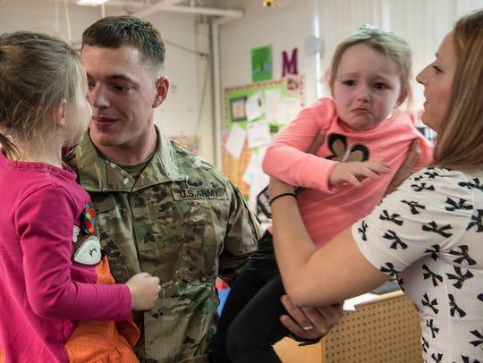 Kaylee Diehl and her dad, Sgt. Michael Diehl, reconnect.