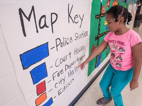 Isabel Rawlings shows the key to the city map.
