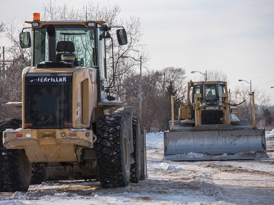 Earthmoving equipment works the site of the future Amazon facility at Eckles and Amrhein Roads.