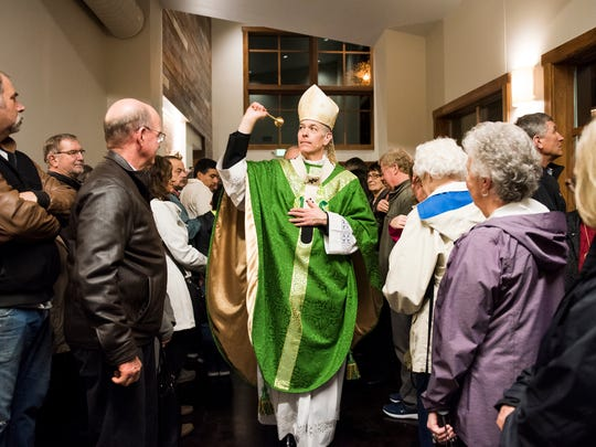 Archbishop Alexander K. Sample sprinkles Holy Water throughout the new parish center at Immaculate Conception Church on Wednesday, Feb. 8, 2017, in Stayton. Sample came from Portland for the church's formal dedication of their new parish center following the celebration.