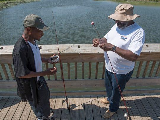 Edmoun Spears and Ezell Robinson Jr. bait their hooks,