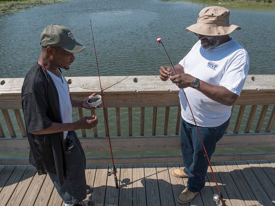 Edmoun Spears and Ezell Robinson Jr. bait their hooks,