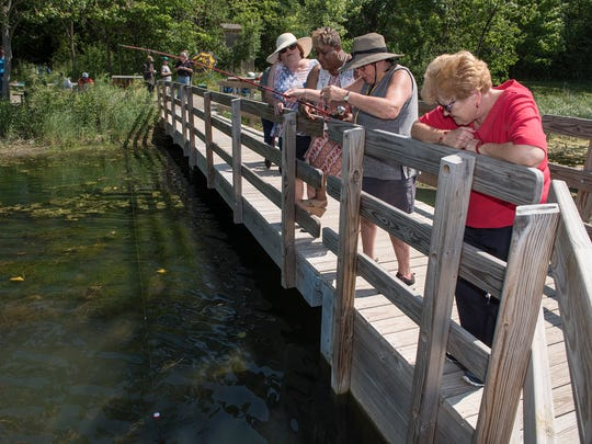 Ellen Rentola from the VFW, Carol Fink from the Nature Center, Regina Thompson from Michigan Veterans Foundation and Marian Belaire, in pursuit of the wily bluegill.