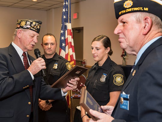Post 32 Commander Larry Fenner presents the award to