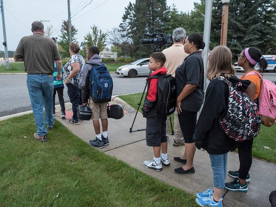 East Middle School students and parents begin a new school day.