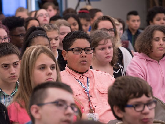The school cafeteria is turned into a courtroom for the day by order of the State Supreme Court, giving students the chance to watch real defendents, lawyers, and judges for Constitution Day.