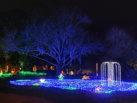 A sparkling blue pond with fountain welcomes visitors to Heathcote's Garden of Lights.