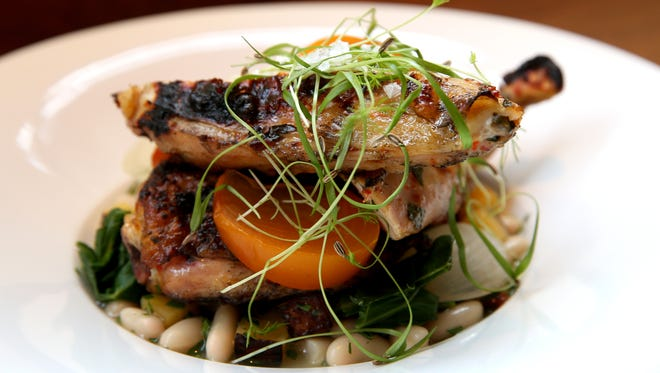Fireplace Aleppo Chicken with cannellini beans, rutabaga, ash onions & pickled persimmon by the Metropole Restaurant on Walnut Street. Photo shot Tuesday December 8, 2015.