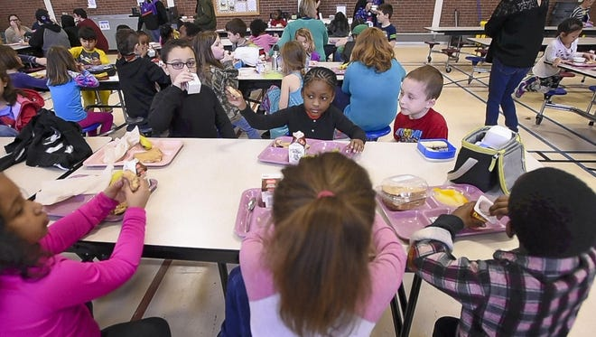Students gather in the gym for lunchtime at the Winooski Educational Center in Winooski in April 2017. According to figures from the Gov. Phil Scott administration on Wednesday, May 9, 2018, Winooski's student-staff ratio is 4.48 students per 1 staff person.