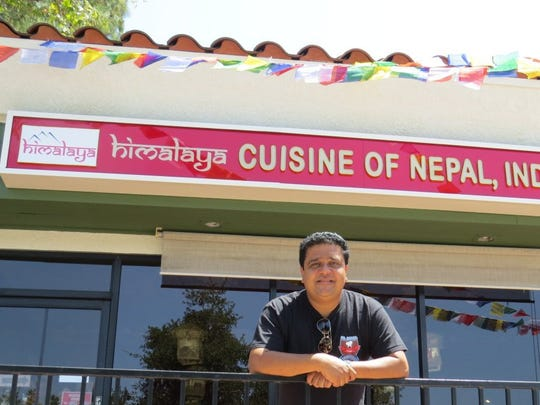 Anup Rimal poses in front of the Thousand Oaks version of Himalaya, his restaurant specializing in the cuisines of Nepal, India and Tibet. It has a sister location in downtown Ventura.