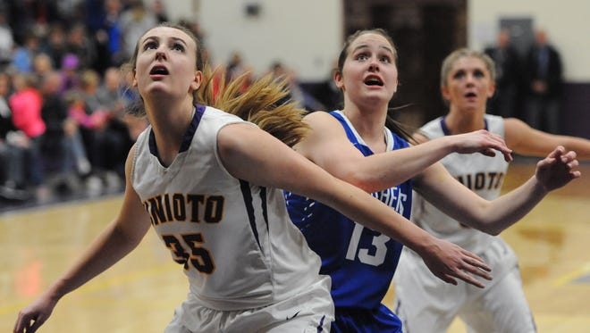 Unioto's Caroline Thiel and Southeastern's Ella Skeens fight for position during last Thursday's contest between the Shermans and the Panthers. The two teams will meet again Thursday night at Southeastern High School.