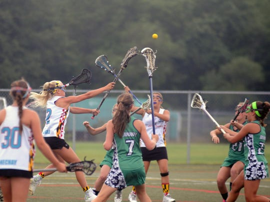 A player for Dolphins Lacrosse, of Ocean City, shoots and scores during the Beach Blast Lacrosse Tournament on Friday at Cape Henlopen High School.