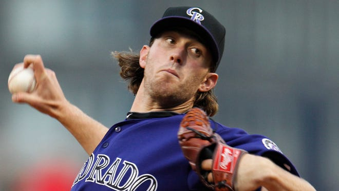 File - In this April 9, 2011, file photo, Colorado Rockies pitcher Greg Reynolds throws in the first inning of a baseball game against the Pittsburgh Pirates in Pittsburgh. A Northern California jury has awarded $2.3 million to the former Major League Baseball pitcher injured after confronting a man high on LSD trying to break into his home. Reynold's attorney, Niall McCarthy, says a San Mateo County jury on Monday, March 19, 2018, awarded Reynolds the money after finding Domenic Pintarelli and Connor Pope liable in a January 2015 incident that left his client with a broken pitching hand. (AP Photo/Gene J. Puskar, File) ORG XMIT: FX104