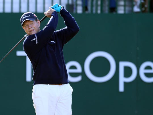 Tom Watson of the US plays a shot off the 1st  tee during the first day of the British Open Golf championship at the Royal Liverpool golf club, Hoylake, England, Thursday July 17, 2014. (AP Photo/Jon Super)