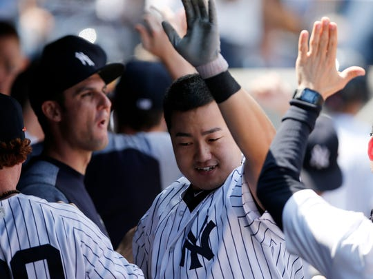 New York Yankees' Ji-Man Choi, center, celebrates with