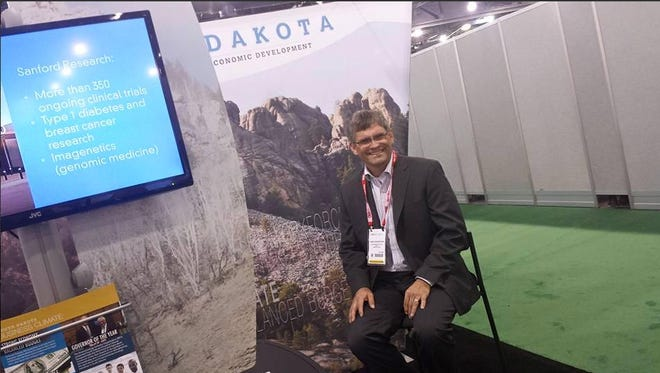 Dan Engerbretson of the GEAR Center at the South Dakota booth at the BIO International Convention.