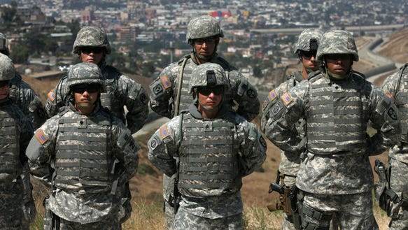 California National Guard troops stand in formation near the California-Mexico border on Aug. 18, 2010, in San Diego.