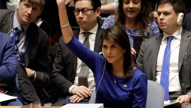 U.S. Ambassador Nikki Haley votes on a resolution during a U.N. Security Council meeting on the Syrian conflict April 14, 2018.