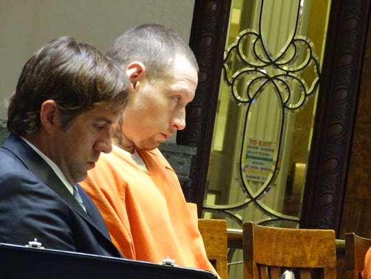 Alfonso Villavicencio Jr. sits with his attorney after