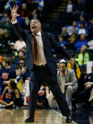 Auburn head coach Bruce Pearl calls allay against LSU during the first half of an NCAA college basketball game in the quarter final round of the Southeastern Conference tournament, Friday, March 13, 2015, in Nashville, Tenn.