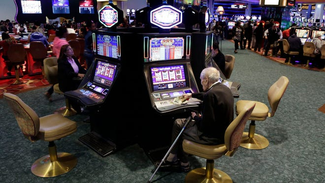 Visitors to the Resorts World Casino at the Aqueduct racetrack play electronic slot machines in the Queens borough of New York. Resorts World was one of the racinos in the state that had positive growth last year.