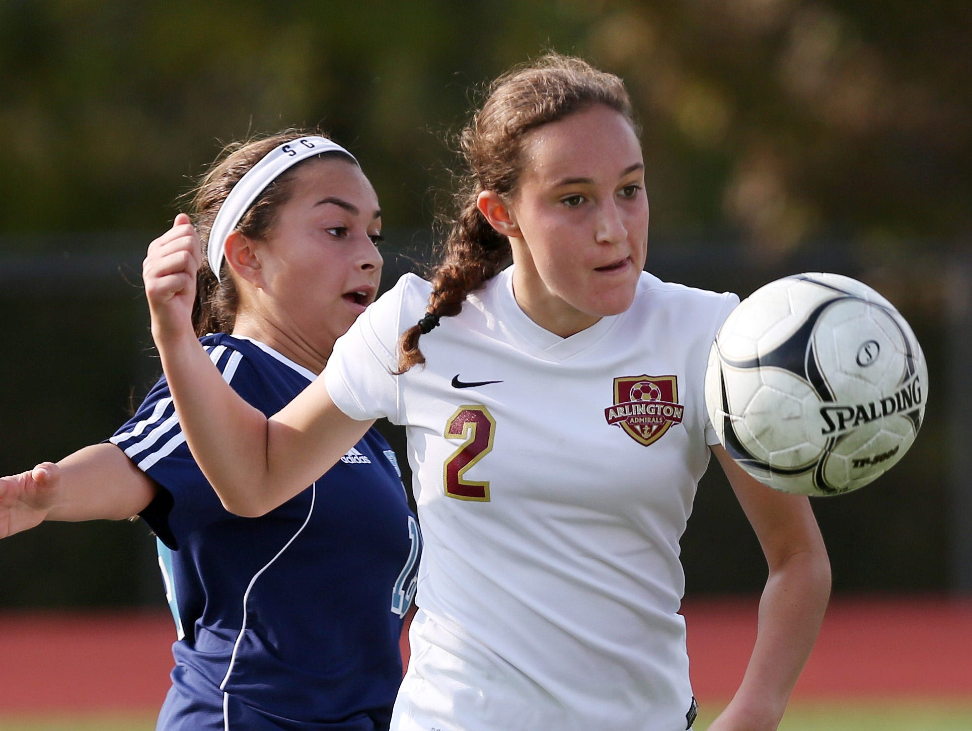Arlington High School's Meggie Buttinger, right, takes control of the ball with a Suffern defender behind her during the Section 1 Class AA championship game at Yorktown High School on Sunday. Arlington won the game 2-0.