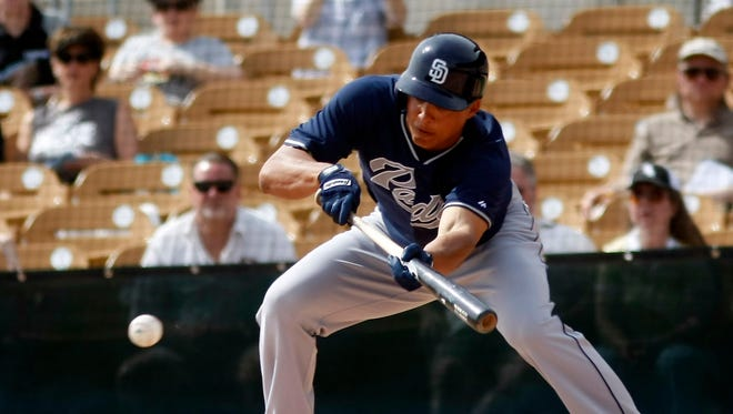 San Diego Padres center fielder Will Venable (25) bunts during the first inning against the Chicago White Sox at Camelback Ranch.