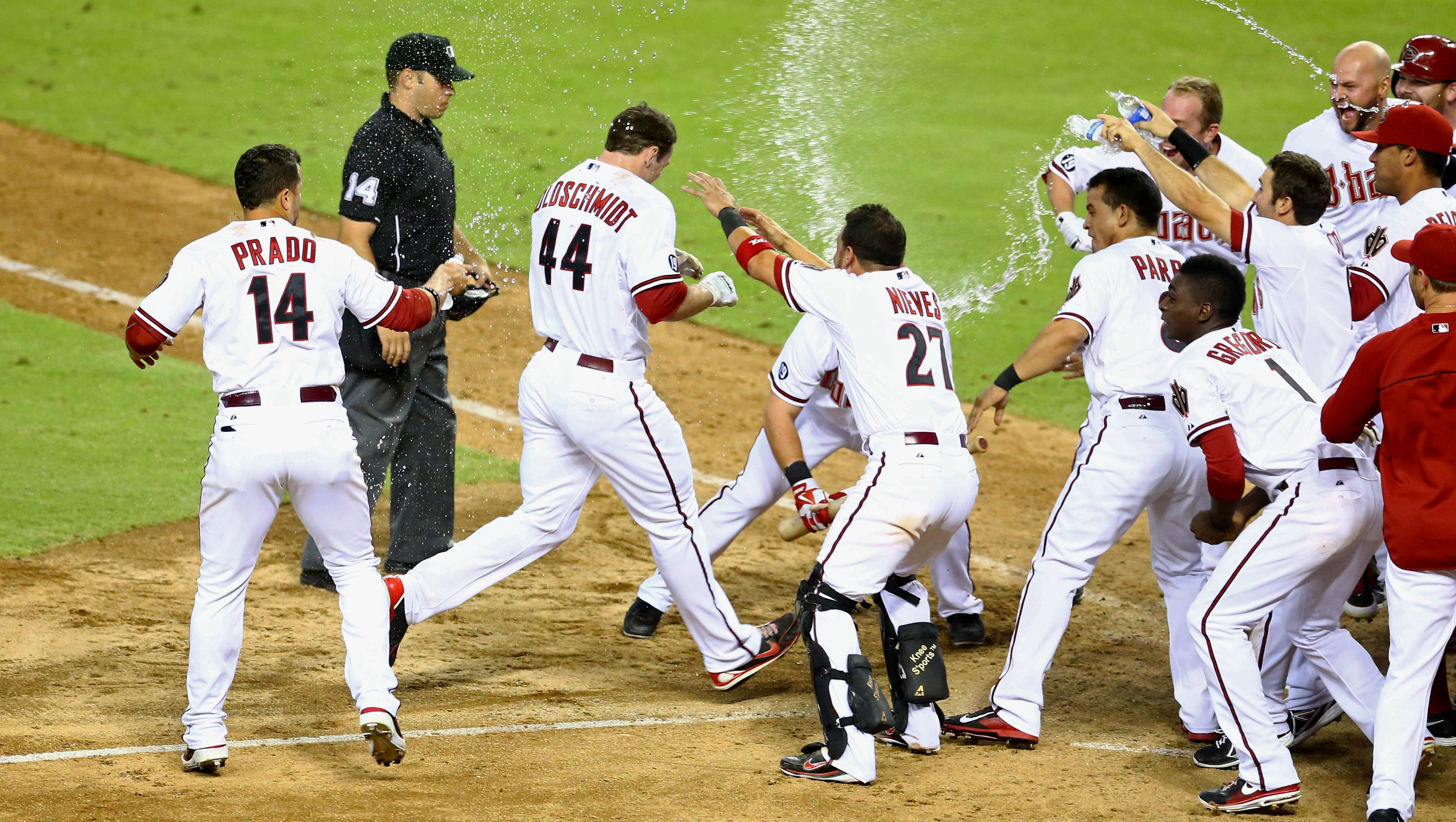 Aug. 9: Diamondbacks' Paul Goldschmidt is congratulated by teammates after hitting a walk-off home run in the ninth inning against the Mets at Chase Field.