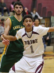 Lakeland's Nick Fazio (25) guards Ossining's Obie Toppin (1) during game action at Ossining High School on Jan. 21, 2016.  Ossining defeated Lakeland 71-48.