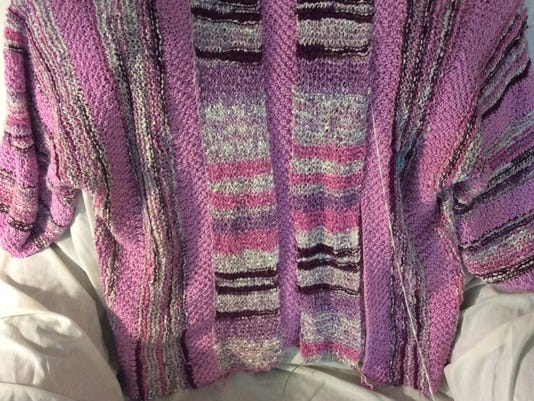 In this photo, I have sewn the ends of the two strips together, and I have sewn the top of the reversed strip in place. As I continue to sew it in place, my aim is to have all the stripes in the plackets match up pretty well. That will mean constantly comparing them as I sew my way down the left side of the sweater.
