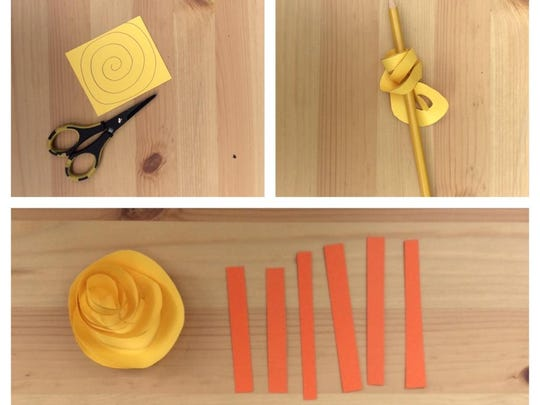 Make a roselike sun out of yellow cardstock roughly 3-by-3 inches. Cut out a spiral, and twirl it on a pencil. Glue the spiral down to its center using hot glue. Cut small strips of orange cardstock at varying lengths for your sunrays.