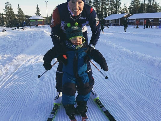 In this 2017 photo provided by U.S. cross-country skier Kikkan Randall, Randall poses with her son Breck in Gallivare, Sweden. Only a fraction of the hundreds of athletes competing in the Winter Games are also parents. Randall had her son after the Sochi Games and is back in Pyeongchang for her fifth and final Olympics. She says she was ready to start a family, but not quite ready to retire from her sport.  (Kikkan Randall via AP)