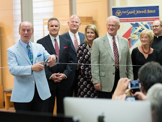 Donald Jackson cuts the ribbon signaling the opening of Carson-Newman University's Lynn and Lyndsey Denton Gallery. Also pictured left to right are: Dr. Paul Percy, Carson-Newman acting president and provost, Clark and Suzanne Denton, Lynn and Lyndsey Denton and Father Eric Hollas, deputy to the President for Advancement at Saint John's University.