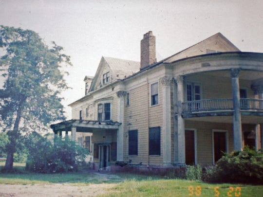 The blighted Greece building is shown in the late 1990s. The property's gradual resurrection began in 2002, when an Oregon-based developer proposed building a senior residential community on the lot.
