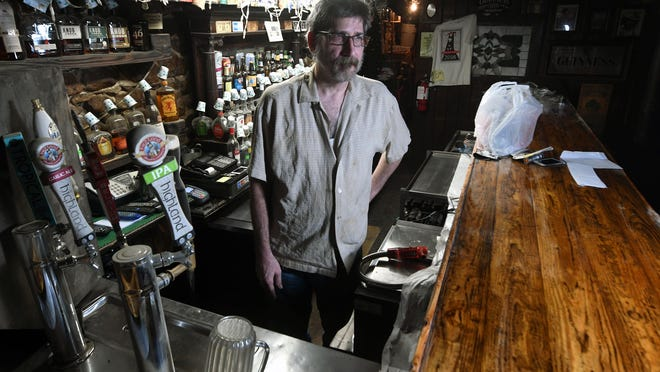 Wilmington artist and Lula's bar owner Bryan Jacobs stands outside the bar in Wilmington, N.C., Thursday, July 9, 2020.