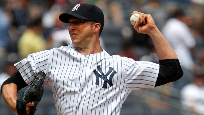 Yankees starter Chris Capuano delivers a pitch against the Blue Jays in the first inning at Yankee Stadium on Saturday