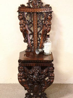 One of two carved chairs purchased by Mikhail Baryshnikov from The Harp Gallery.