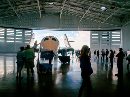 Members of the public walk around the hanger and examine
