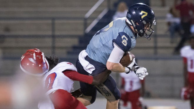 Eagles defender Allen Johnson (10) loses his helmet while attempting to tackle Dolphins wide receiver Spencer Segal (7) during the Pine Forest vs Gulf Breeze high school football game in Gulf Breeze on Friday, September 15, 2017.